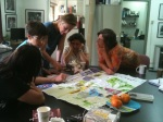 Women from the group examine this year's Arnona map